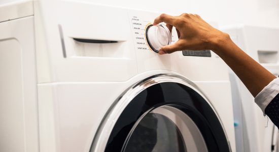 Bouton allumer d'une machine à laver le linge